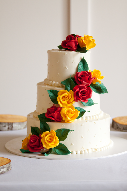 red and yellow flowers wedding cake