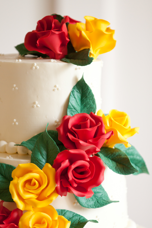 wedding cake red and yellow flowers oregon
