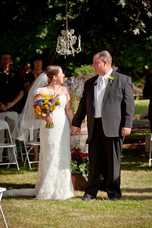 outdoor wedding chandelier ceremony