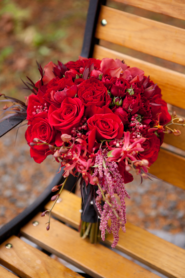 red roses winter berries bouquet