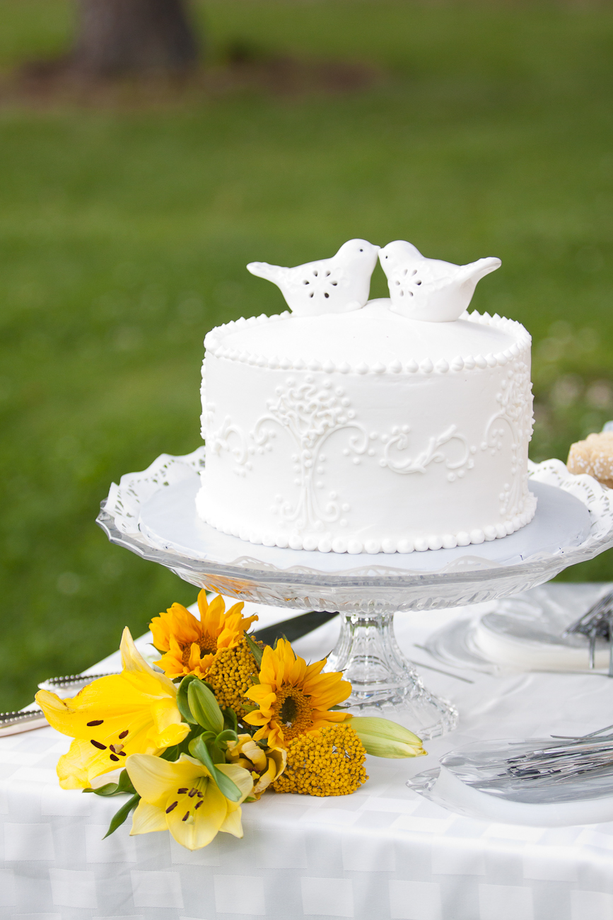 all white wedding cake with with topper