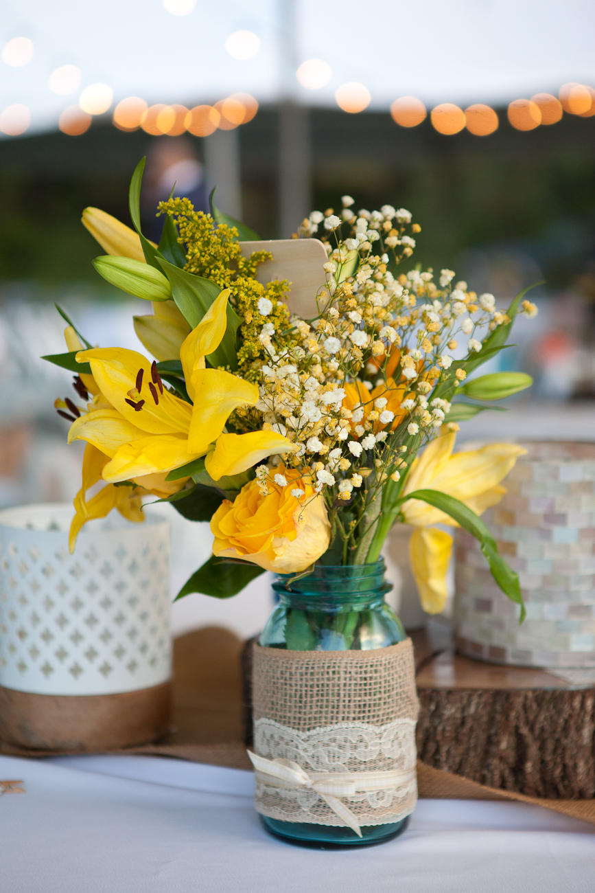 blue mason jar centerpiece yellow flowers burlap string lights