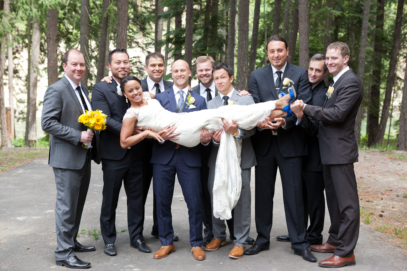 groomsmen carrying bride