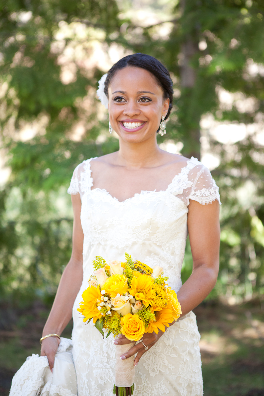 lace bridal gown with yellow bouquet