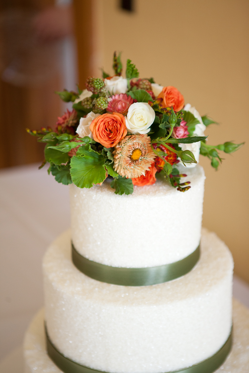 cake_topper_green_berries_orange_flowers