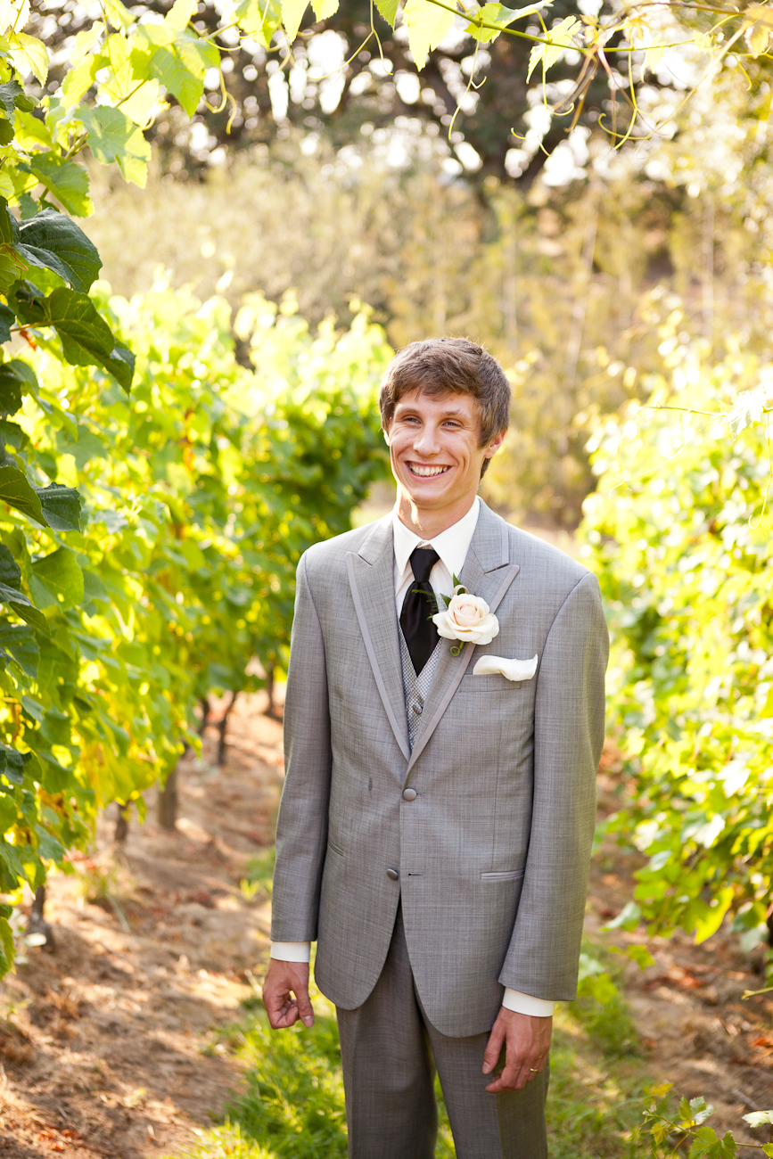 groom_grey_suit_aurora_colony_vineyard