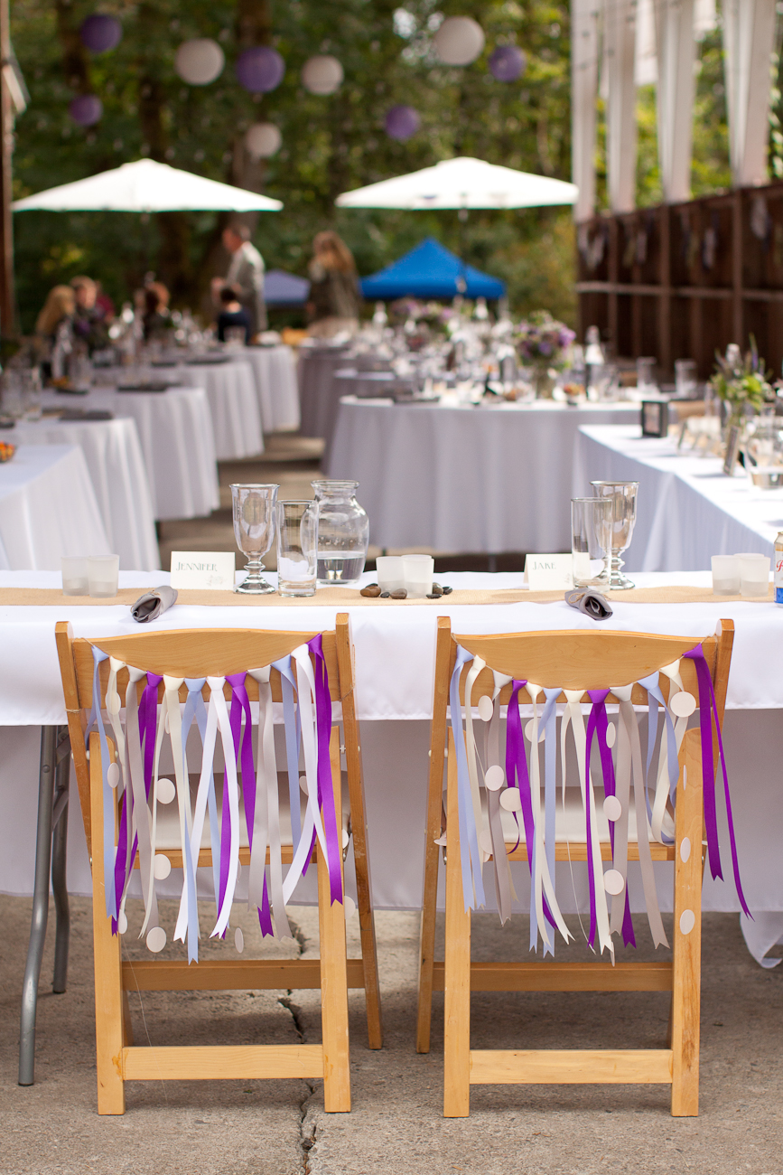 purple-decorations-for-bride-and-groom-chairs