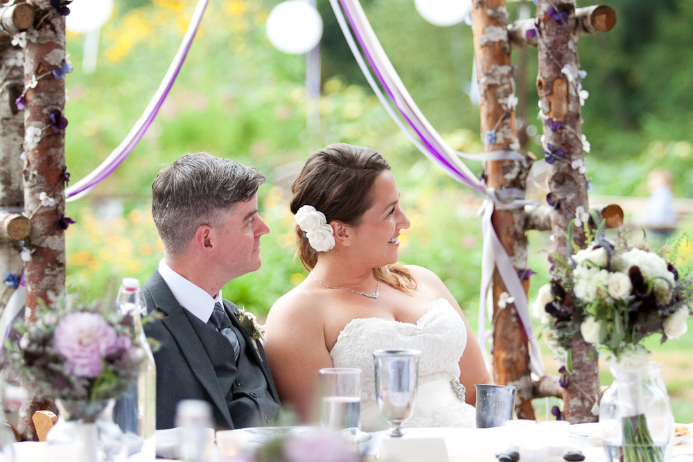 wedding-archway-made-of-branches-purple