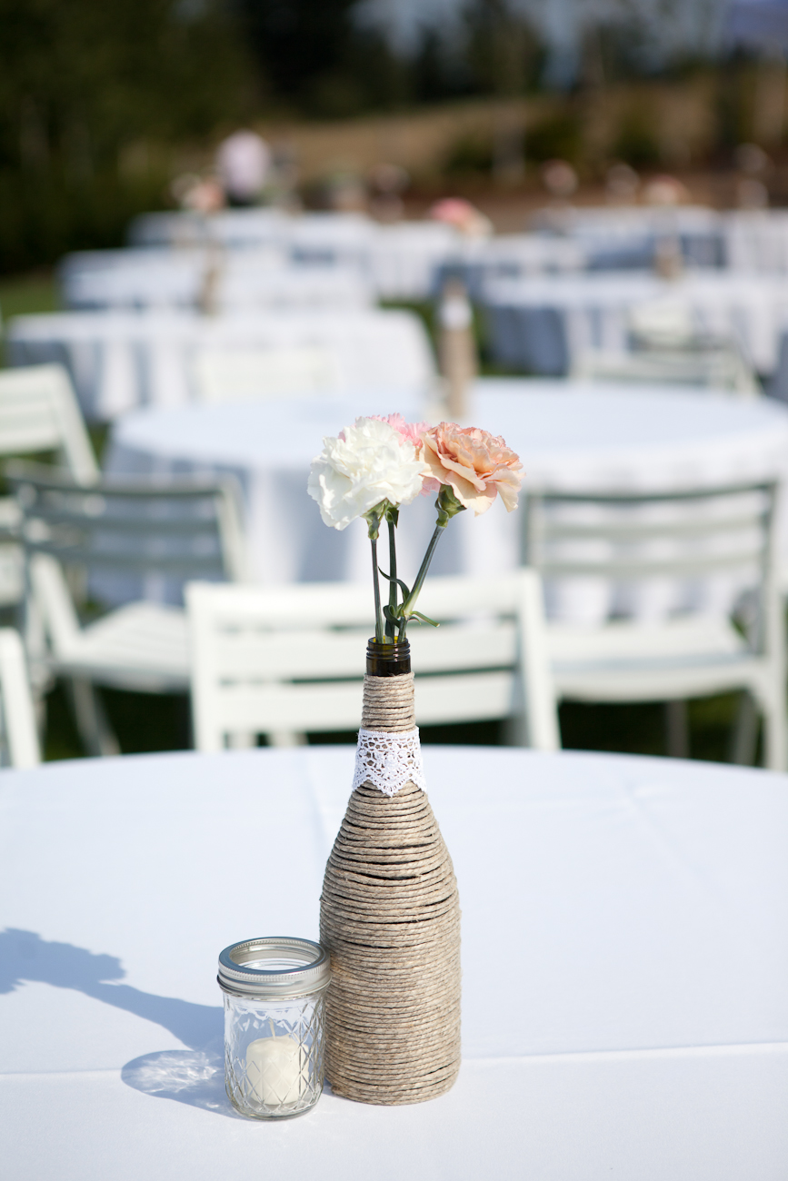 wedding_centerpiece_twine_wrapped_bottles_carnations