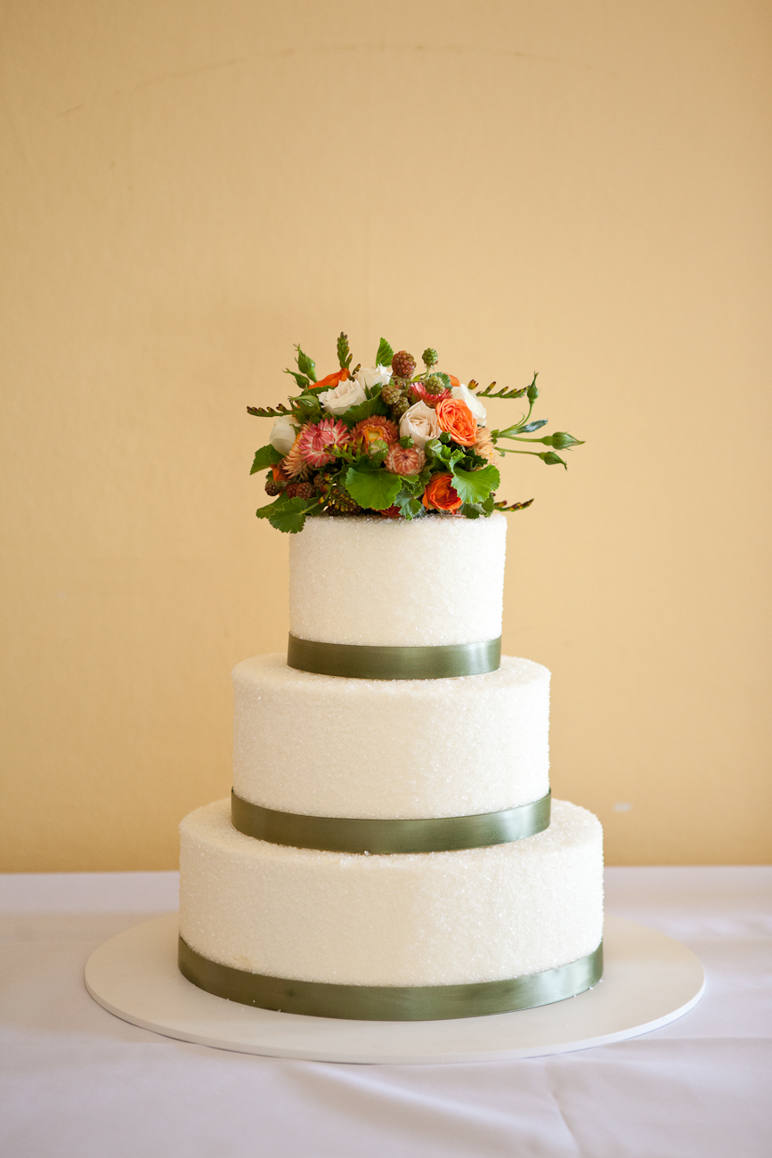 white_green_wedding_cake_with_orange_flowers