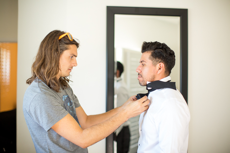 groom tying bowtie malibu wedding-1